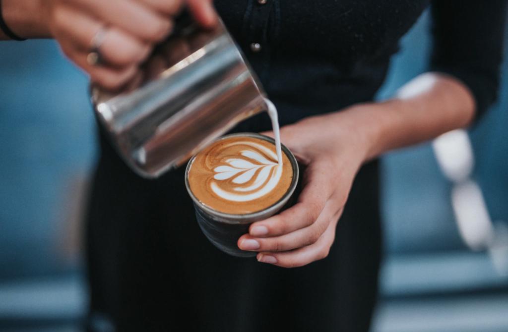 barista pouring latte, part-time job