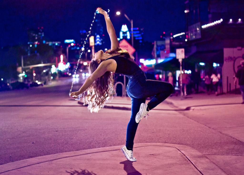 woman dancing on street, reading week