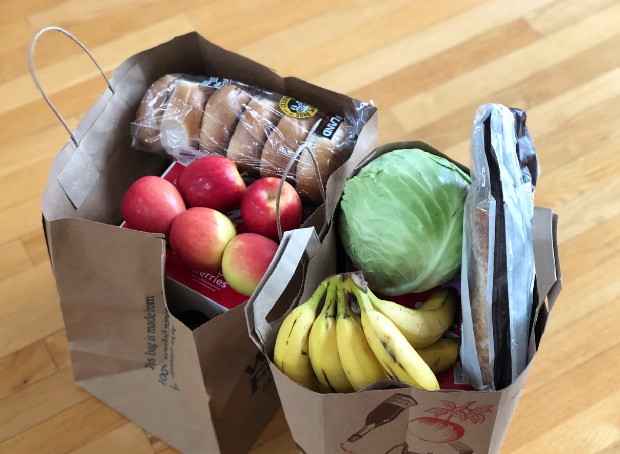 on-campus grocery spots, paper bags with fruits