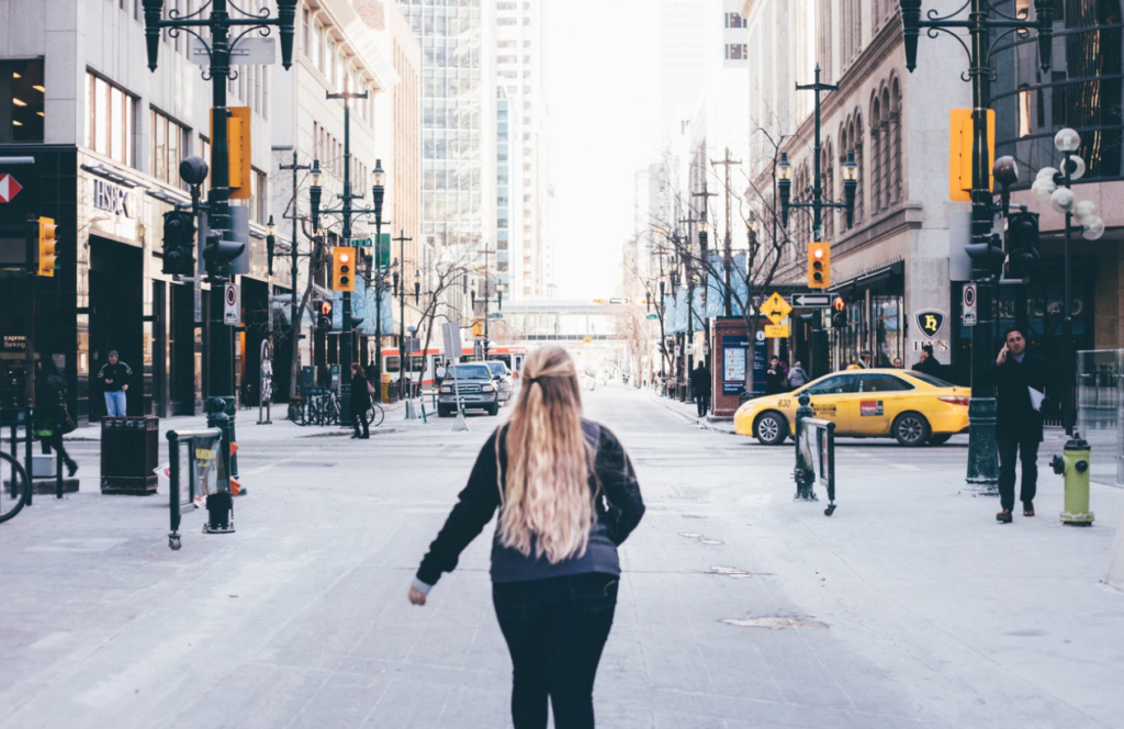 mental health resources at the university of calgary, student walking on street