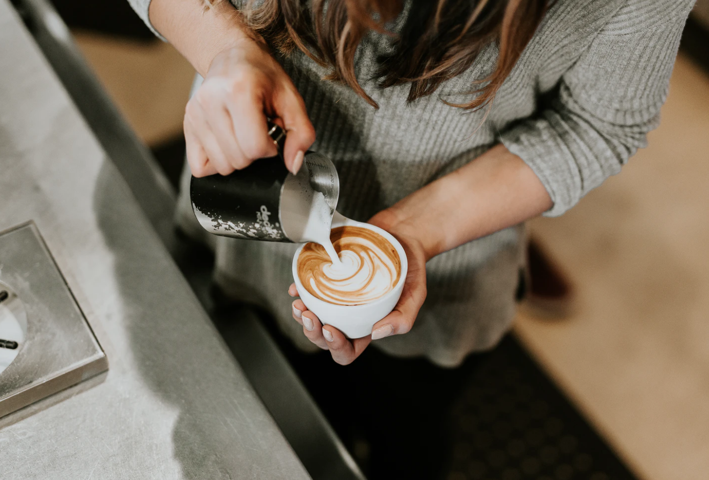 barista pouring coffee part-time jobs