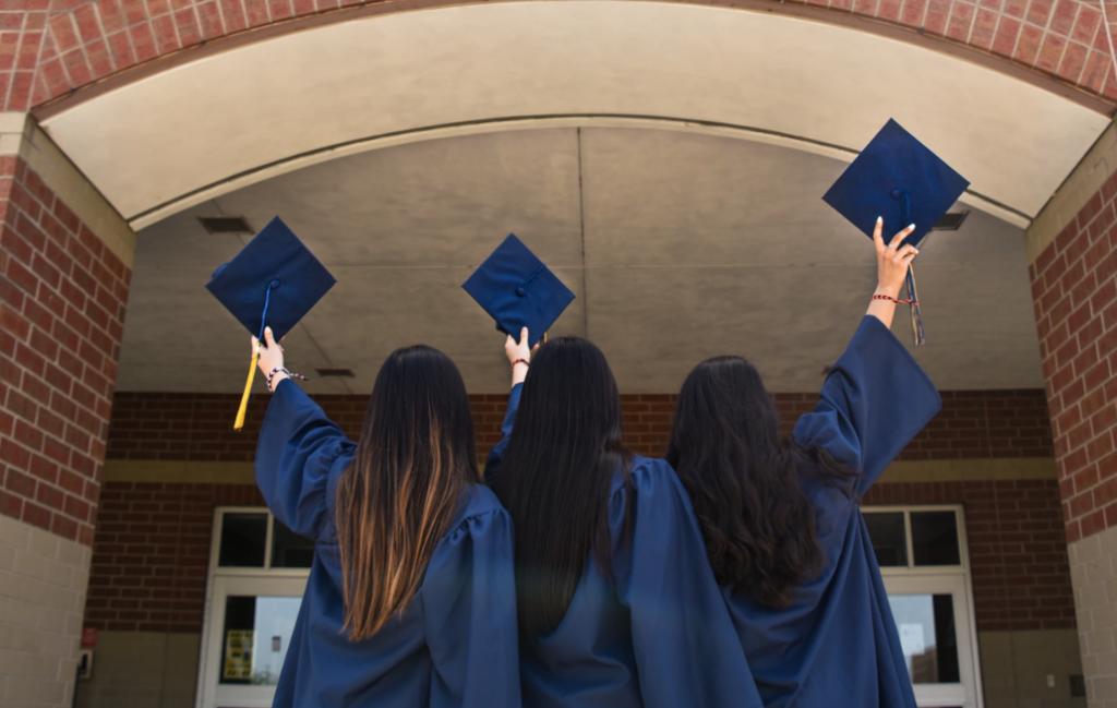 toronto grads three graduates holding caps