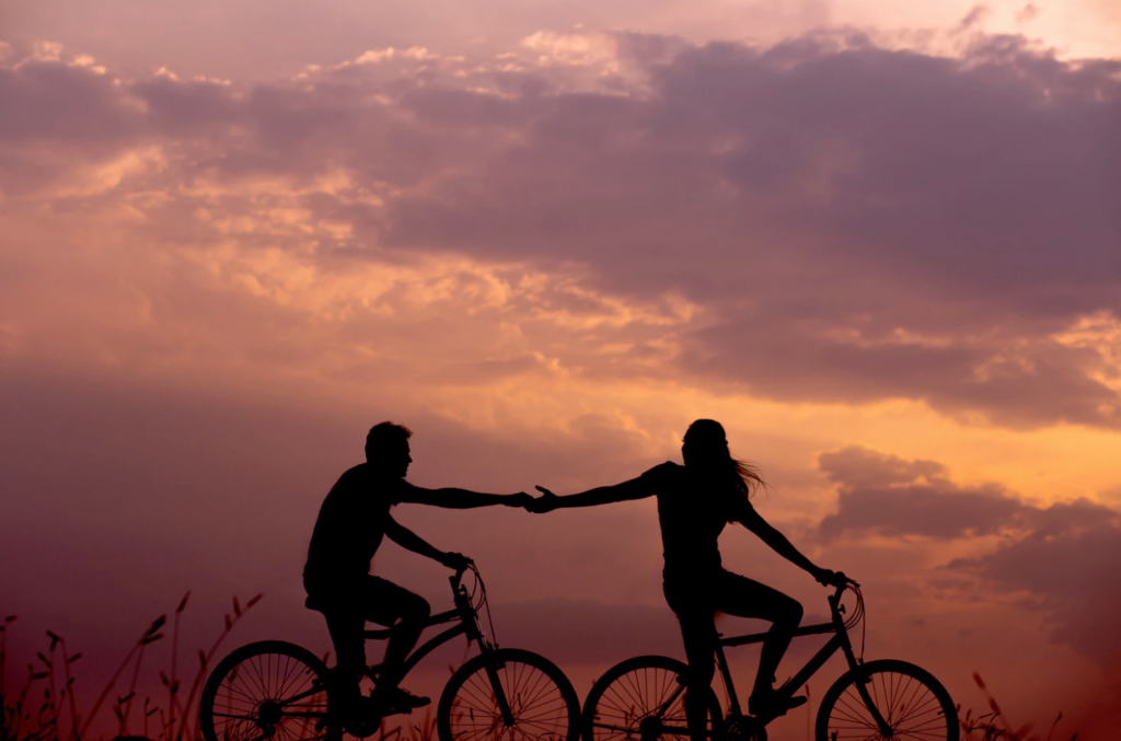 date spots for mount allison university students bike riders holding hands during sunset