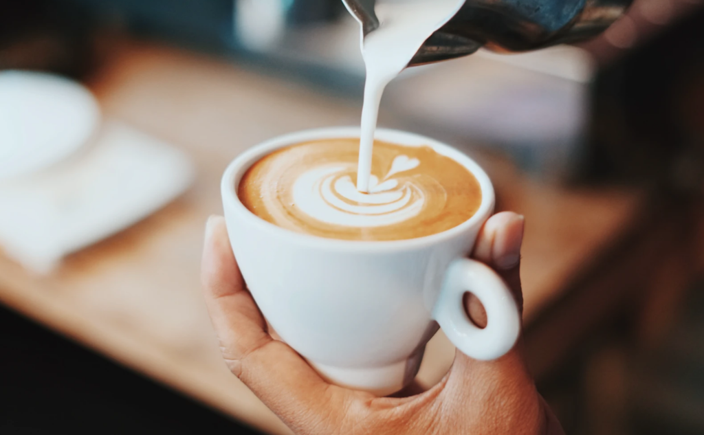 north atlantic coffee spots , barista pouring latte with heart