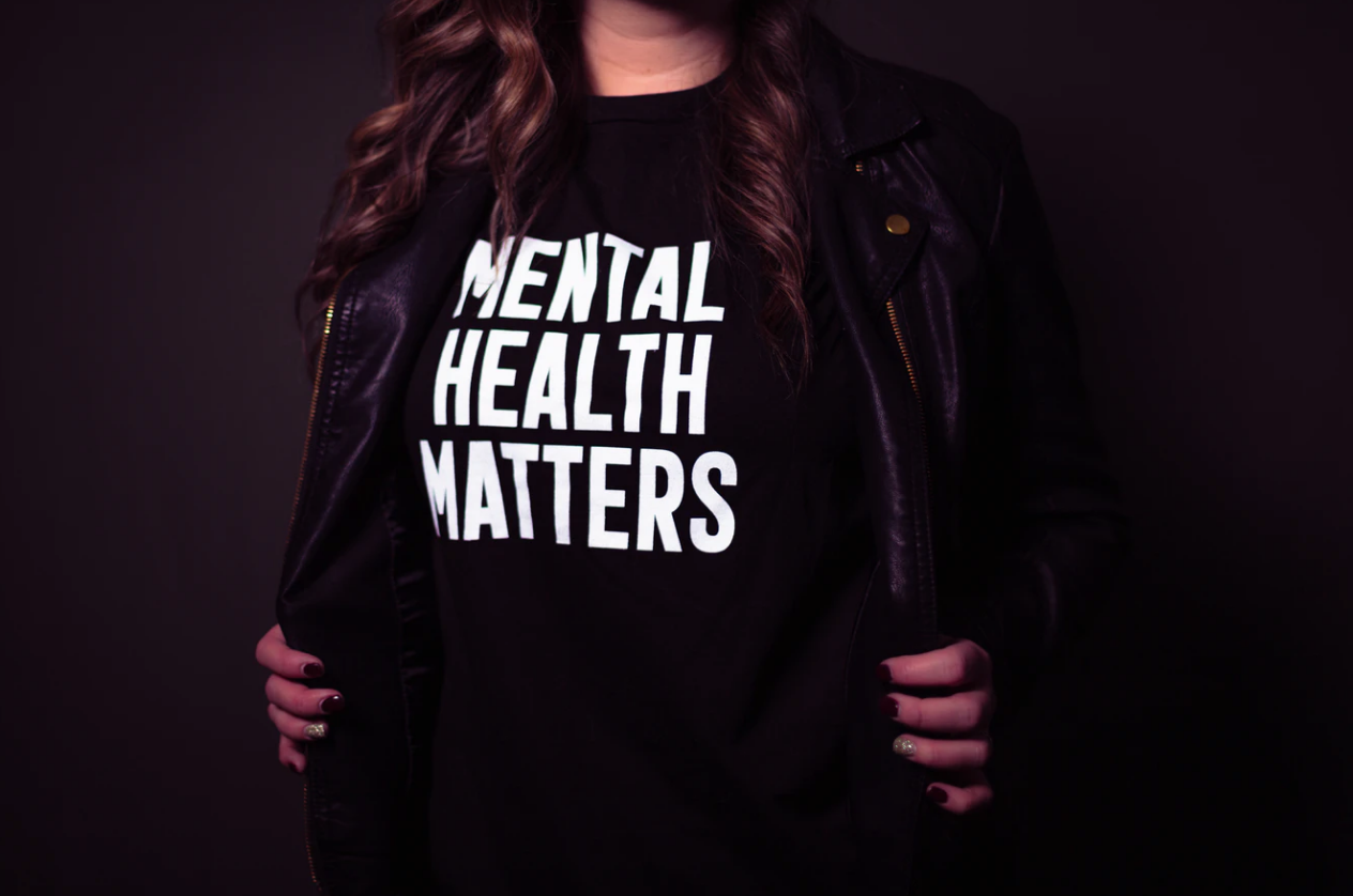 """newfoundland's mental health resources , person opening jacket to reveal a """"mental health matters"""" shirt"""