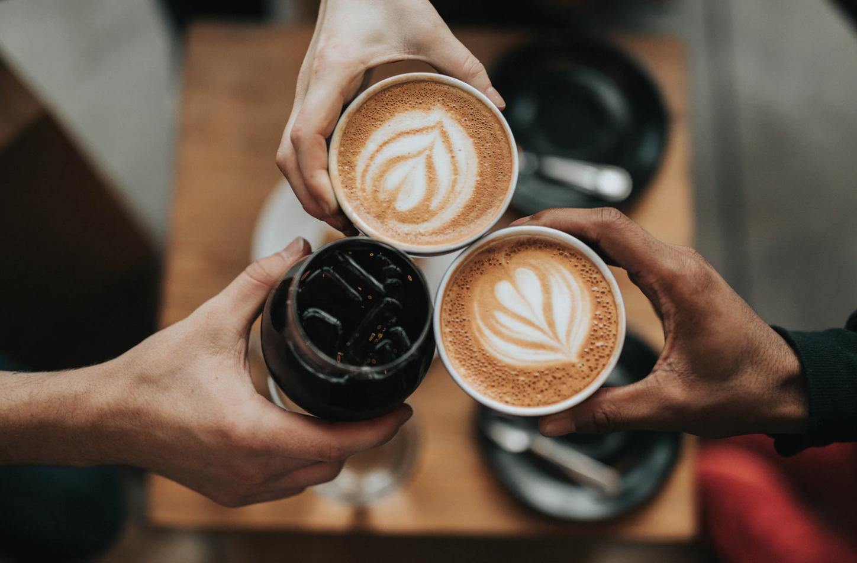 coffee at dalhousie university three people cheersing lattes